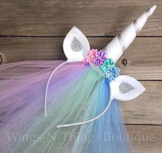 CELESTIA UNICORN PRINCESS PONY HEADBAND w/ tulle veil This adorable handmade headband is adorned with silk flowers and rhinestones. The ears are made of felt and are curved to add dimension. The sparkly felt unicorn horn is an amazing 6 tall, and wrapped with beautiful silk ribbon. A