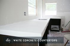 DIY-Concrete-Countertops-_-Chris-Loves-Julia | Sealing the white concrete countertops.