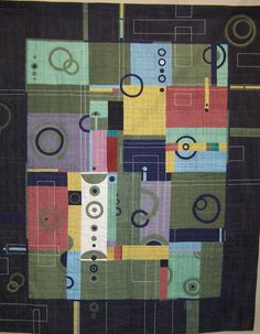 Geometric quilt - awesome show quilt!  I love the white Sashiko that rises above the blocks.