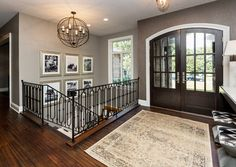 Dark wood door with white trim - Plumwood Dr - Transitional - Entry - Other Metro - Meghan Blum