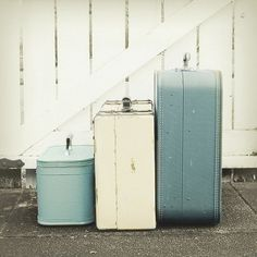 blue vintage suitcases..I have always loved old suitcases, but never collected any this color.  That means I will be on the search..........