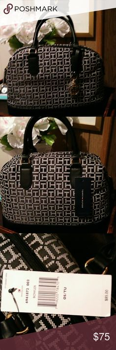 """""""Tommy Hilfiger"""" (Bowler )handbag Black and white monogrammed trimmed in faux leather , top zipper closure , blue interior with one open pocket and one zipper . Across 13"""" depth 10"""" handles 9"""" Tommy Hilfiger Bags Satchels"""