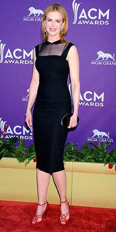 NICOLE KIDMAN    Supporting her country crooner hubby, the actress spices up a demure schoolgirl-collared frock with sexy, strappy red sandals (both by L'Wren Scott) and drop earrings.