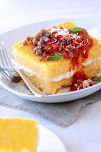 Layers of Italian polenta with a filling of yummy cheeses! What else could you want this winter season? // Cheesy Stuffed Polenta with Sausage #pomodorofresco #delallorecipes