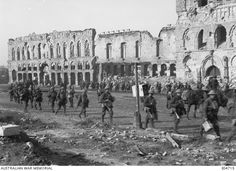 Canadians troops passing the ruined Cloth Hall while on their way to relieve the Australian troops at Passchendaele. Passchendaele was later captured, after the withdrawal of Australian forces from the Ypres area, on 10 November 1917 by the 1st Canadian Division.