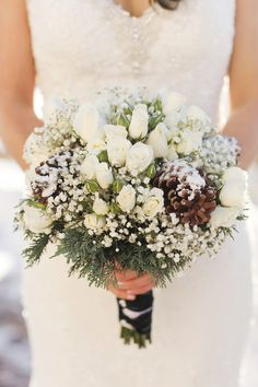 Winter bridal bouquet idea - white roses, pinecones, baby's breath + fresh evergreens {Pepper Nix Photography}