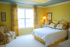 Catchy Yellow Teenage Girls Bedroom Paint Color Idea with Yellow-white Bedding Set and White Bedside Tables and Cream Slipcovered Armless Chair also Yellow Wall Paint Color and Yellow Window Curtains