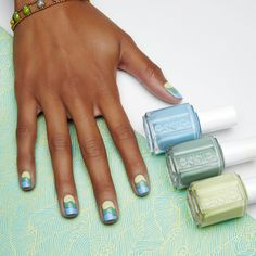 To get this cancer (June 22 to July 22) zodiac nail look, start near the cuticle, paint a thin, lime green swirl. Use a teal polish for the middle wave and sky blue for the wave at your tips. Make sure to leave a little negative space between the waves so they each stand out (and don't blend together).