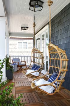 Hanging Rattan Porch Chairs with Blue Stripe Pillows - Transitional - Porch Outdoor Spaces, Outdoor Living, Outdoor Decor, Farmhouse Porch Swings, Front Porch Swings, Front Porch Chairs, Farmhouse Table, Farmhouse Ideas, Front Porch Lights