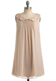 Love the neckline in this sweet little dress!