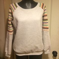 NWT super soft comfy and cute crew neck sweatshirt light heather grey sweatshirt so soft and cozy with super cute knit material for 3/4 of the long sleeves. New with tags. simple yet stylish! LF Tops Sweatshirts & Hoodies