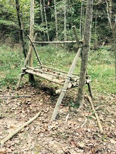 A raised bed platform (jungle hooch) near completion on our survival shelter course.