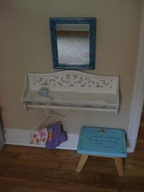 Attach shelf under mirror for Laila to do her hair.. Use pink shelf that is housing her baby items and clothes.