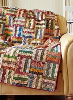 Great scrappy quilt. A perfect use for leftover strips from other projects! by alexandra