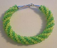 Neon green and yellow beaded Kumihimo bracelet by Jewellery by Janine https://www.facebook.com/JewelleryByJanine