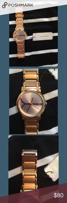 BCBG MaxAzria Copper Colored Watch Never before worn BCBG copper colored watch. There is some spots on the lower part of the band as shown in the image. I would imagine a cleaning agent for copper could be used to remove. Will need new battery which should be around $5 or $10. Thank you! BCBGMaxAzria Accessories Watches