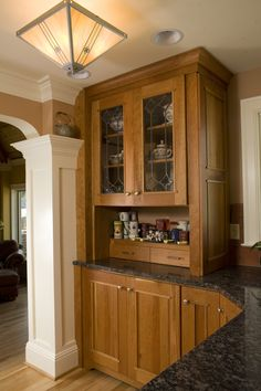 craftsman kitchen cabinetry; cabinet style, cabinet color, floor color, counter color.