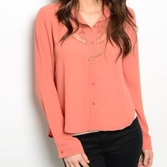 NWT Asymmetrical Chiffon Blouse NWT asymmetrical coral chiffon blouse. Long sleeves with sheer cut out design in the front and in the back. Love this shirt!! Size LARGE. Tops