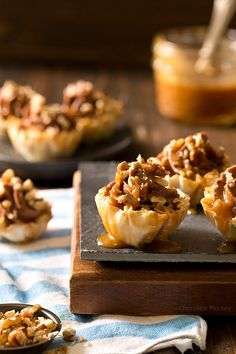 Looking for a bite-sized dessert to share with family and friends? These easy-to-serve No Bake Turtle Cheesecake Phyllo Cups with chocolate, caramel, and pecans will be a popular hit! Dessert Cake Recipes, Dessert Cups, Mini Desserts, Sweet Desserts, Finger Desserts, Sweets Recipes, Healthy Desserts, Dessert Ideas, Baking Recipes
