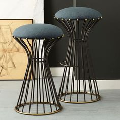 Adelphi Bar + Counter Stools feature antique brass-finished detailing on a striking black matte finish frame.