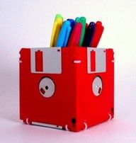 """Remember these old floppy discs? Just hot glue gun them into a box shape and use on your desk for a """"retro"""" pen cup"""