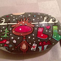 Cute whimsical Rudolph painted rock with stockings hung on his antlers. Pebble Painting, Love Painting, Pebble Art, Stone Crafts, Rock Crafts, Arts And Crafts, Christmas Rock, Christmas Crafts, Christmas Ideas