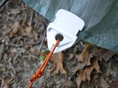 """These little clips (""""EasyKlips"""") actually grip onto anything as long as there is pressure on the line. Perfect for hanging tarps - and a lot of other things. They come in a bigger size, too."""