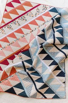 Gather is fresh new HST quilt pattern from Suzyquilts.com. This pattern is the last in a series of quilts that each focus on learning a different skill and this design focuses on cutting and sewing HSTs and building a quilt top asymmetrically. Included in the pattern is a video tutorial and links to blog posts that walk you through everything that you need to know to make this fun and modern quilt pattern! There will also be a sew-along starting in 2021! #trianglequilt #modernquiltpattern