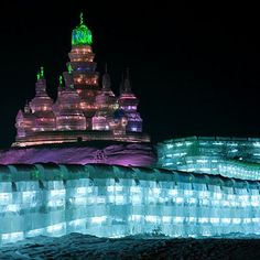This massive, glowing castle (constructed for the Harbin Ice and Snow Festival in China) stands at over 150 feet and includes a replica of the Great Wall of China, which doubles as a 300-foot-long ice slide.  | Photo: Ken Larmon/Flickr | thisoldhouse.com