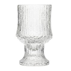 Iittala Ultima Thule Red Wine Glasses, this range was inspired by the melting ice in Lapland, Tapio Wirkkala originally created the surface in the 1960s after carving into a graphic mould. An exclusive design reflecting the thousands of hours spent perfecting the glass-blowing technique required to produce the effect. The patterns gradually change as the glass burns the surface of the wooden moulds. The Ultima Thule range was originally created for the First Class Cabins in the Finnair…