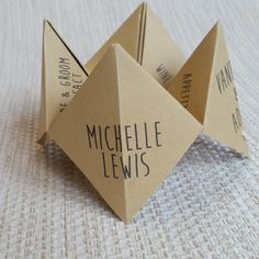 ♥..............................................................................................................♥ A unique and creative place card. Ideal for those looking for something different to get your guests conversations started as soon as they sit down at the table. The Place card is the classic origami game we all used to play when we were children. On the outside it includes the Bride & Grooms names, wedding date and each guests name. On the first inside layer it includes your ...