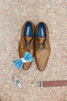 Bright blue bowtie and classic leather: http://www.stylemepretty.com/destination-weddings/2015/11/21/elegant-white-wedding-in-greece-2/ | Photography: Peter & Veronika - http://peterandveronika.com/language/en/