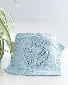 Lacy knit dishcloth is reminiscent of tulips in spring. Shown in Lily Sugar'n Cream. Knit pattern