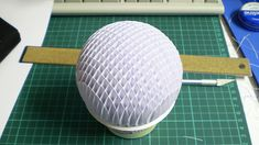 Savio Ku: Sphere Sliceform  A sphere paper sliceform model. The circles are printed out then all slots are hand measured and cut. Each sheet is spaced 5mm apart.