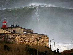 US surfer Garrett McNamara rides a giant wave in Portugal on 1/28/13~