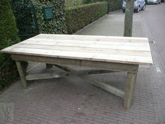 Simple but huge garden table made from recovered scaffold planks and construction wood