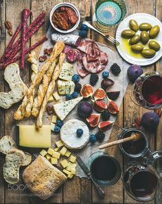 Wine and snack set with wines meat bread olives fruits by 2enroute