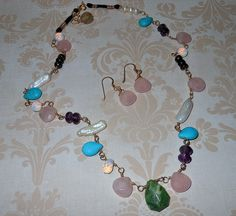 OOAK Multi-stone necklace and earring set (rose quartz, howlite, amethyst, bronzite, freshwater pearls, jasper, opalite, and banded onyx) wrapped in 14kt gold filled. A must have!