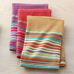 Set of 3 durable cotton dish towels are woven by women in Nepal in complimentary colors with distinct multicolored stripes. Hanging loops. Machine wash cold. 26in. l x 21 1/2in. w   See the hand-weaving process for Mahaguthi's textiles in this short video.