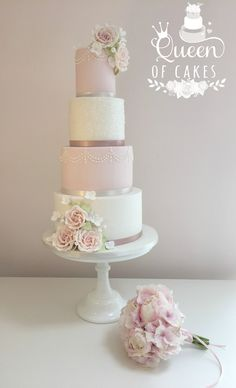Pretty pink and white glitter wedding cake with pale blush sugar roses