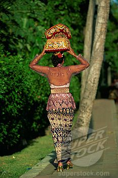 SuperStock - Woman carrying temple offerings, Bali, Indonesia, Southeast Asia, Asia