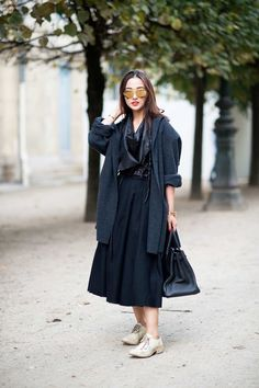Paris Fashion Week 2014 street style.  Now Black on Black is just as hot as White on White.