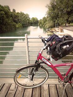 Sul ponte dello Stella in bici, Precenicco. Little bridge on river Stella in Precenicco, near Udine, Italy.