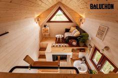 This beautiful house on wheels may look tiny, but it can easily fit a family of three thanks to its space-saving interior design. French tiny house company Baluchon designed the ultimate home for wandering minimalists, giving it a fitting name . Best Tiny House, Modern Tiny House, Tiny House Living, Tiny House Plans, Tiny House Design, Tiny House On Wheels, Living Room, Tiny House Loft, Tiny House Movement