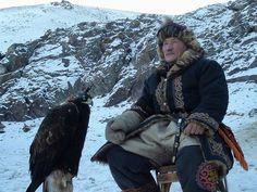 Kazakh eagle hunter with traditional  clothe