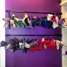Cheer bows holder! I could never find a GOOD method of storing all the cheer bows so I created my own and inexpensive method!  Curtain rod, wall brackets and shower curtain hooks. Voila! I chose shower hooks that are easily opened and closed while on the bar. Can fit 2-3 bows per hook without them getting scrunched or bent.