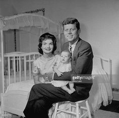 Sen John Kennedy w wife Jacqueline holding their new baby Caroline in her nursery at their Georgetown home