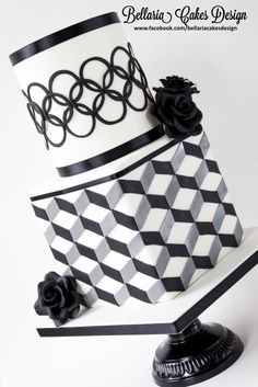 Modern black and white bridalshower cake with geometric patterns. - Modern black and white geometrical bridalshower cake This would kick ass if a green fondant qbert was jumping somewhere on the bottom tier in the back. Pretty Cakes, Beautiful Cakes, Amazing Cakes, Fondant Cakes, Cupcake Cakes, Cupcakes, Geometric Cake, Geometric Patterns, Great Gatsby Cake