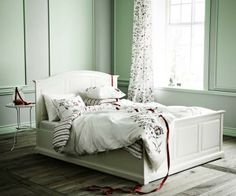 Contrasting wall frames give dimension to a sparsely furnished sleep space. | Photo: Courtesy of IKEA