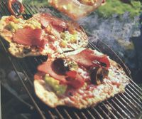 Pizza on the grill. Good idea for camping.